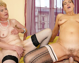 Two mature sluts with huge tits finger their wet pussies 10